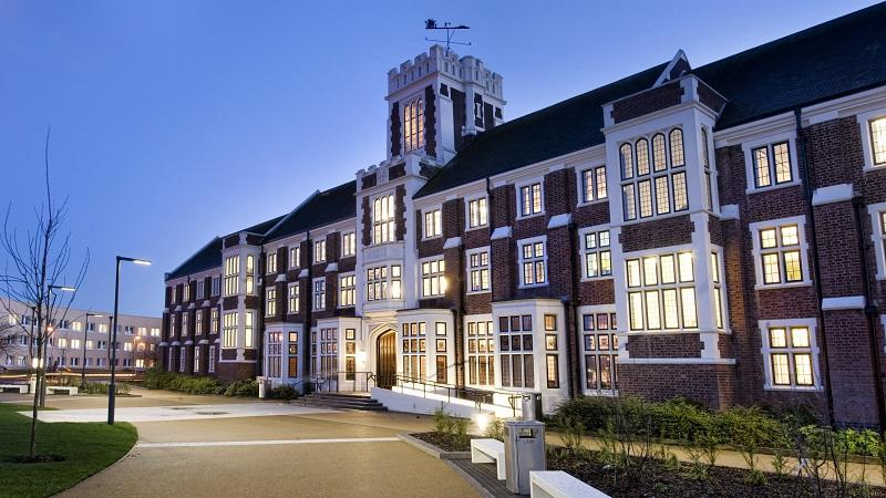 An image of the exterior of Loughborough University's Hazlerigg building at dusk