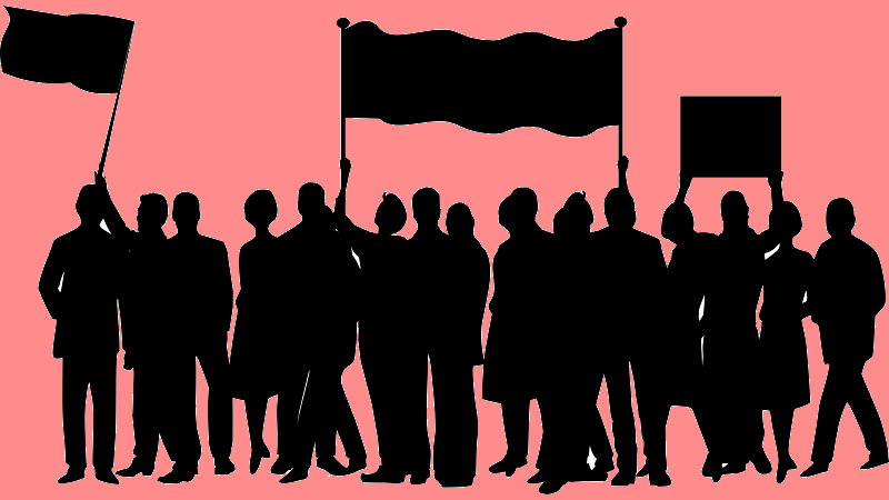 A silhouetted image of a group of people protesting with banners and flags
