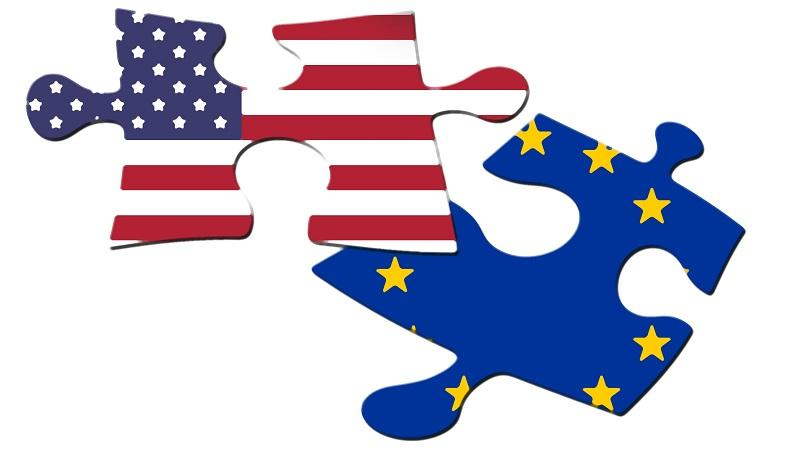 An illustration of two puzzle pieces bearing the respective images of the US and EU flags