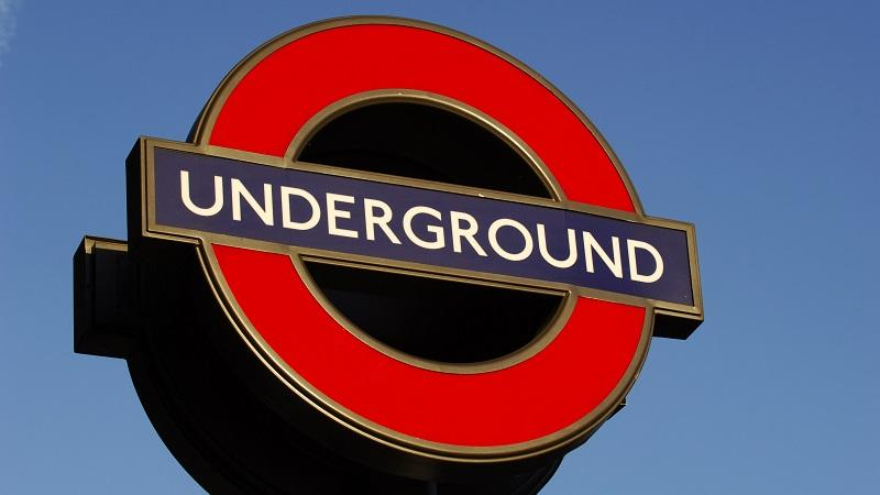 An image of a London Underground sign outside a station