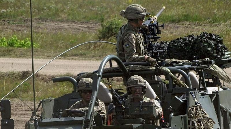 An image of British soldiers sat in a tank taking part in an exercise in Poland