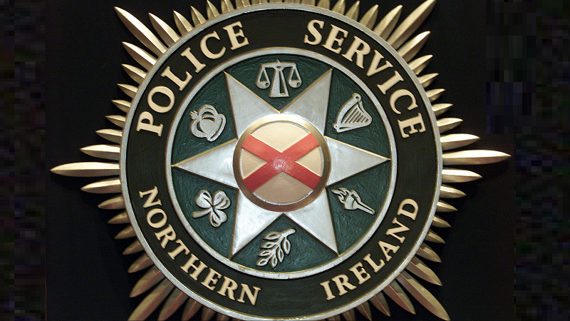 A close-up image of the Police Service of Northern Ireland logo displayed on a badge