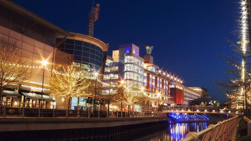 An image of Reading's Oracle centre lit up at night
