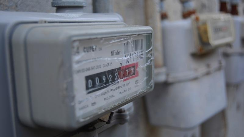 A close-up image of an electricity meter attached to a wall