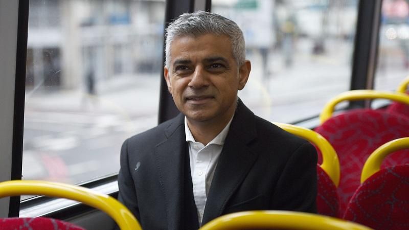 An image of London mayor Sadiq Khan sitting on a bus