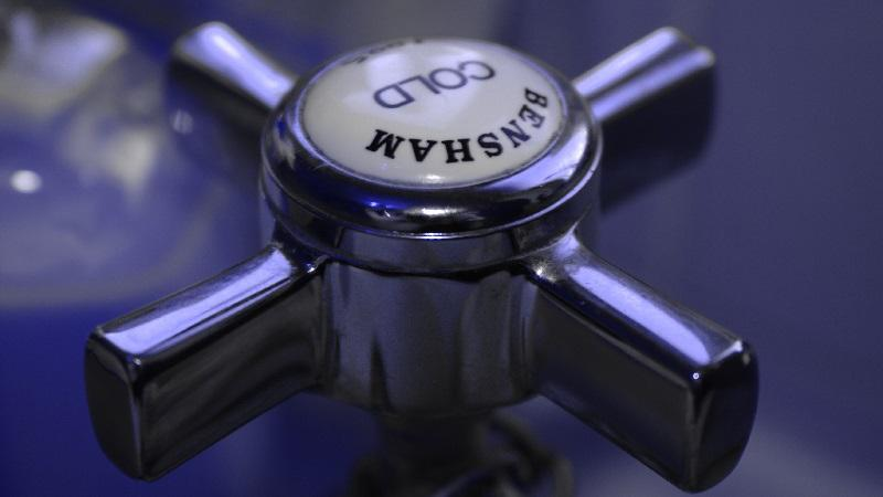 A close-up image of the head of a cold tap