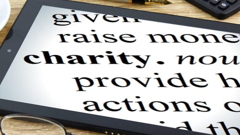 An image of the definition of the word 'Charity' displayed on a tablet computer screen