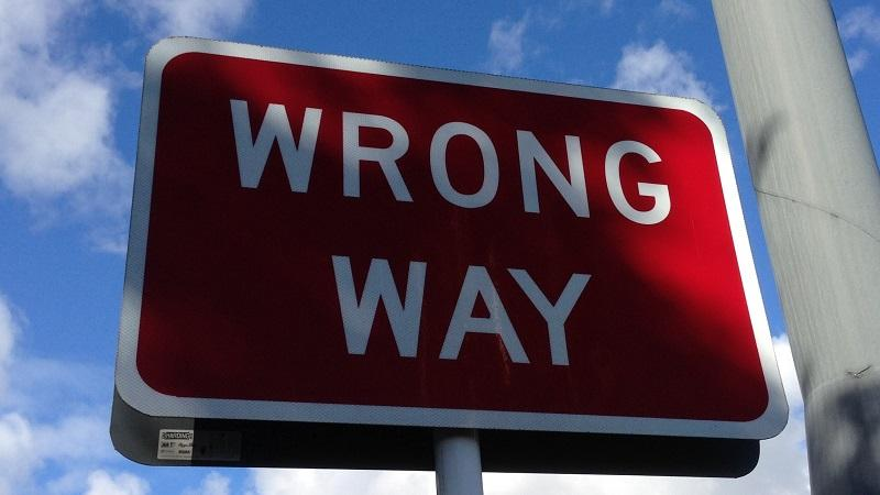 Close-up image of a sign saying 'Wrong way'