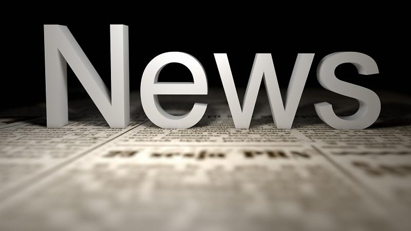 A close-up image of the word 'News' resting atop a newspaper