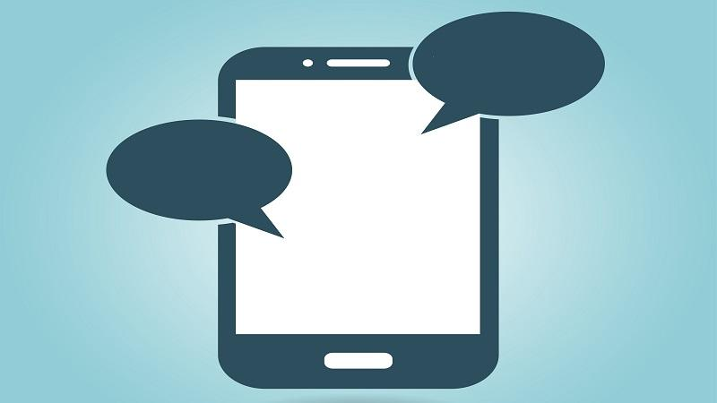 An illustration of a smartphone with two speech bubbles emanating from it