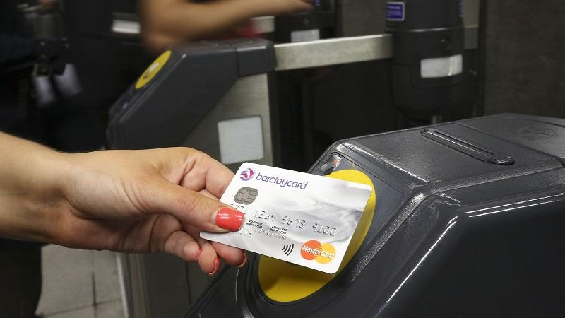 An image of a contactless payment card being used on the ticket barriers on London Underground