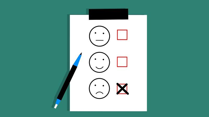 An image of a feedback form with a cross next to an unhappy face