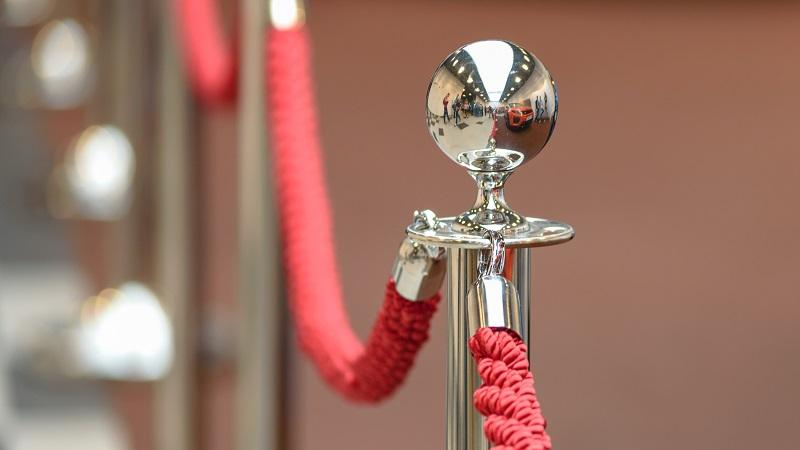 A close-up image of a red rope encircling a VIP area
