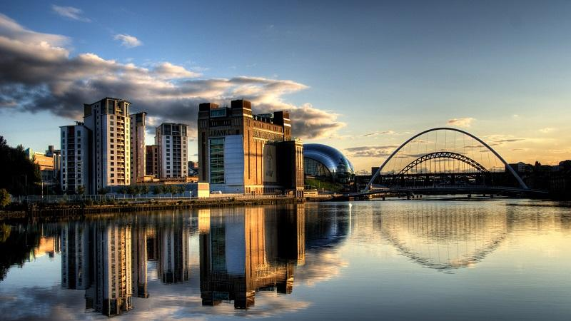An image of the Newcastle/Gateshead Quayside with the Millennium Bridge in the background