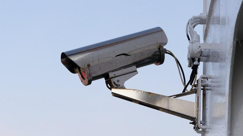 Image of a security camera mounted on a wall