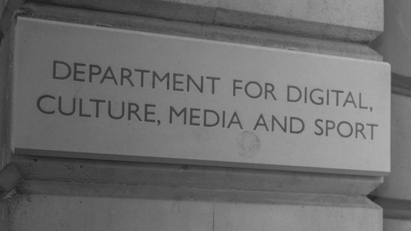 A close-up of the signage on the outside of the head offices of the Department for Digital, Culture, Media and Sport