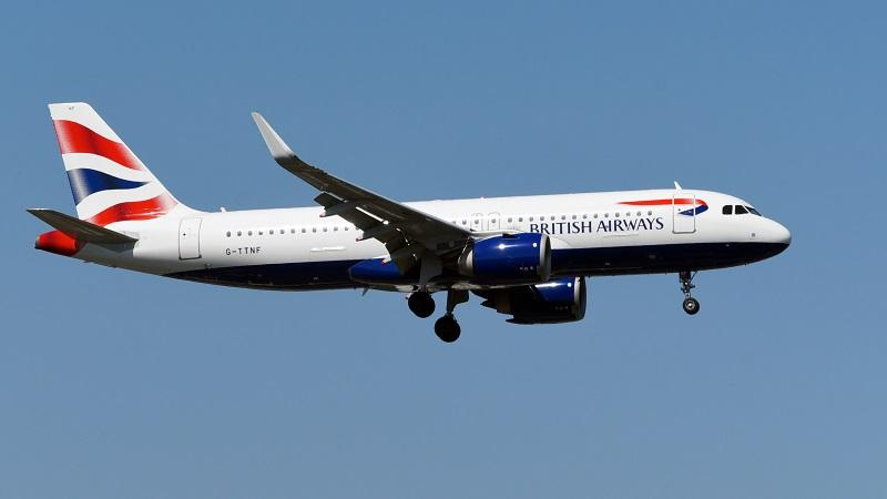 An image of a British Airways plane in flight against a blue sky