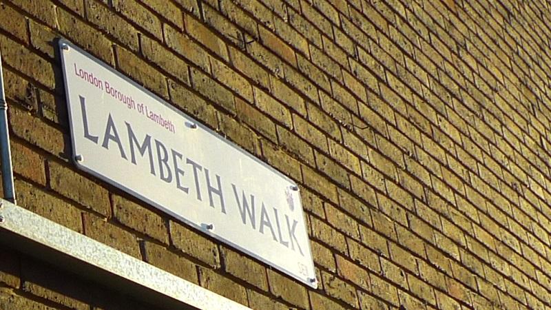 A close up of a Lambeth Walk street sign on a wall