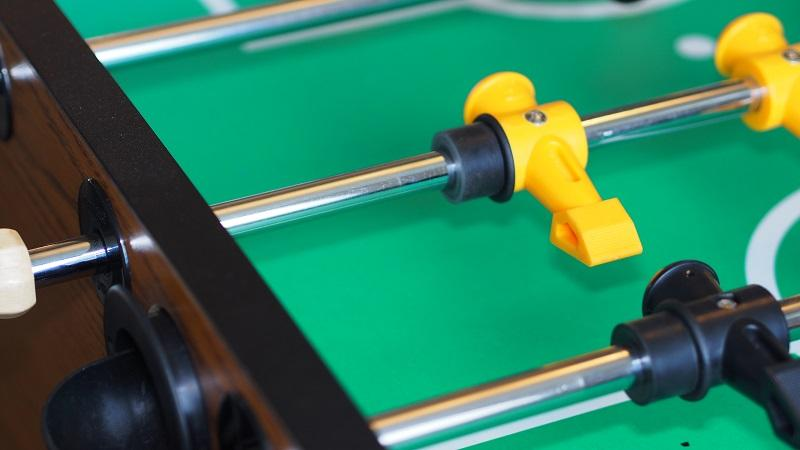 A close-up image of a section of a table football table