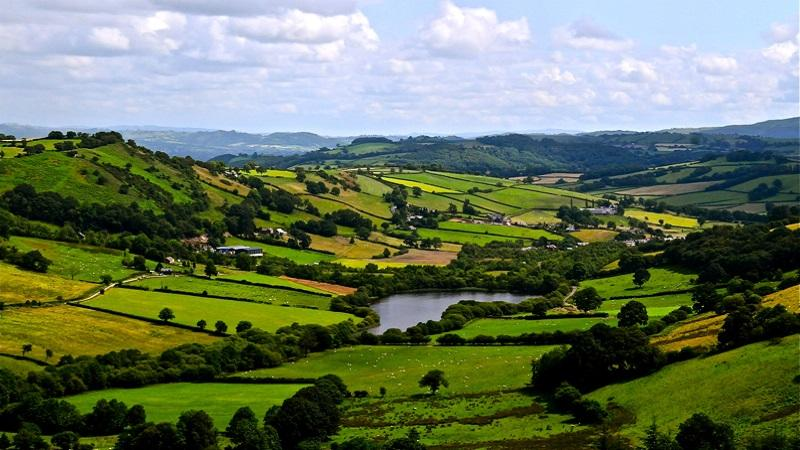 An image of valleys, fields and lakes in Llanidloes Without in Powys
