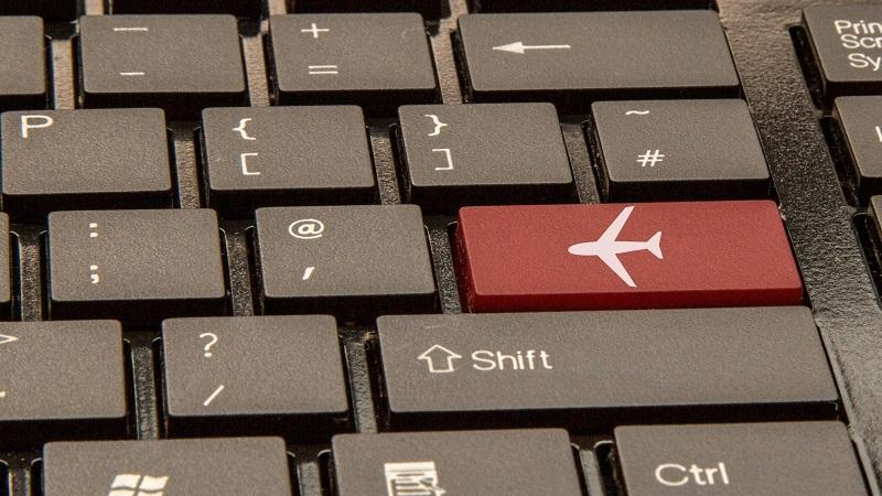 An image of a keyboard with an illustration of a plane on what would normally be the enter key