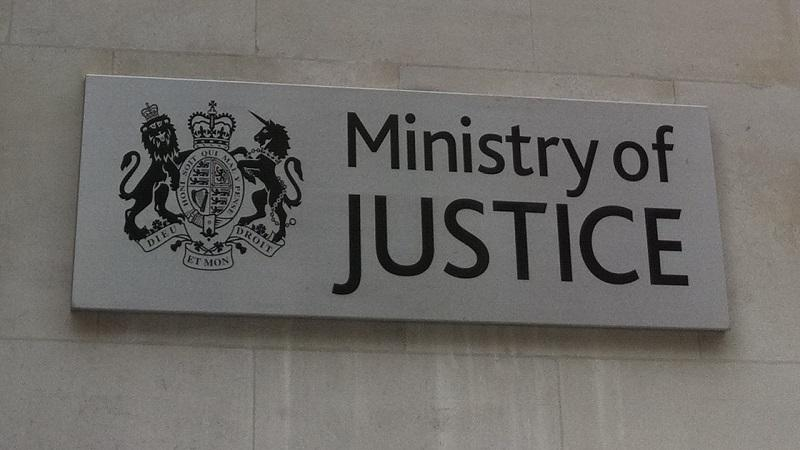 A close-up image of a Ministry of Justice sign