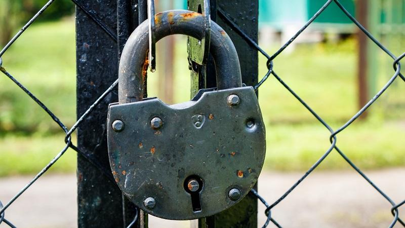 An image of a padlocked gate