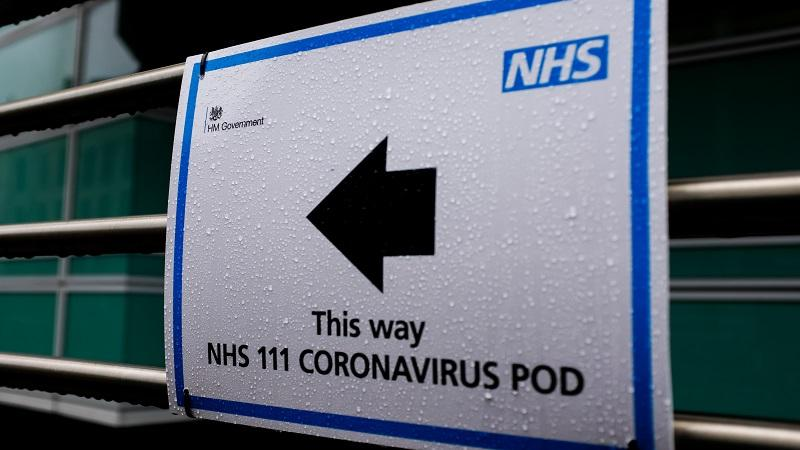 An image of a sign pointing people towards an NHS coronavirus 'pod' clinic