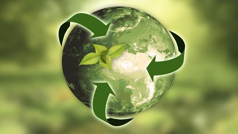 An illustration of a green earth encased by arrows similar to the logo indicating recyclability