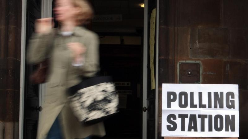 A woman leaving a polling station