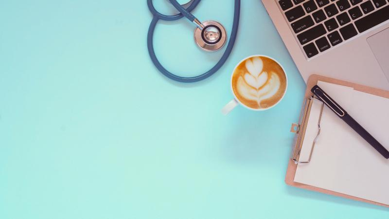 Vintage Stethoscope doctor equipment mockup on flat blue table top view background concept for hospital office workplace