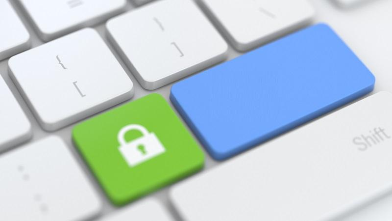 A close-up image of a keyboard with a long blank blue key next to a green key with a padlock