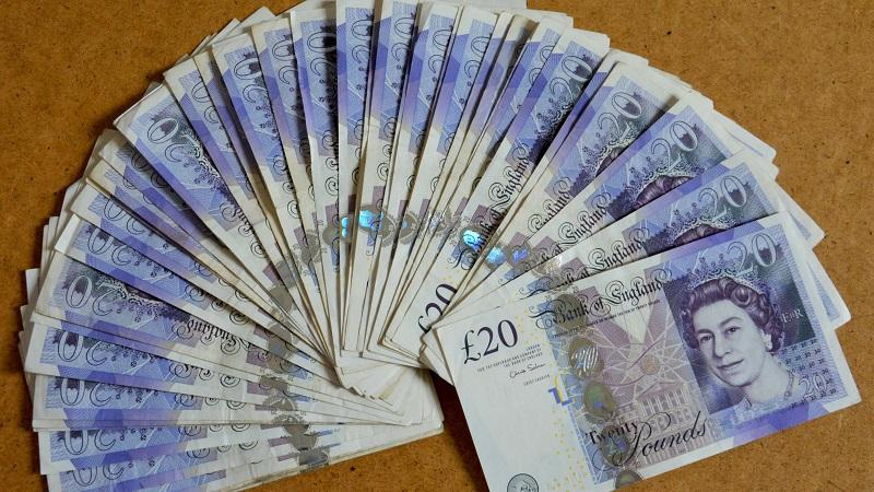 An image of a fan of £20 notes
