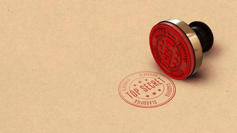 A close-up image of a red ink stamp reading 'Classified - Top Secret'