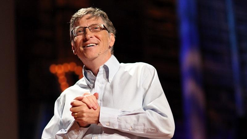 An image of Bill Gates speaking at an event