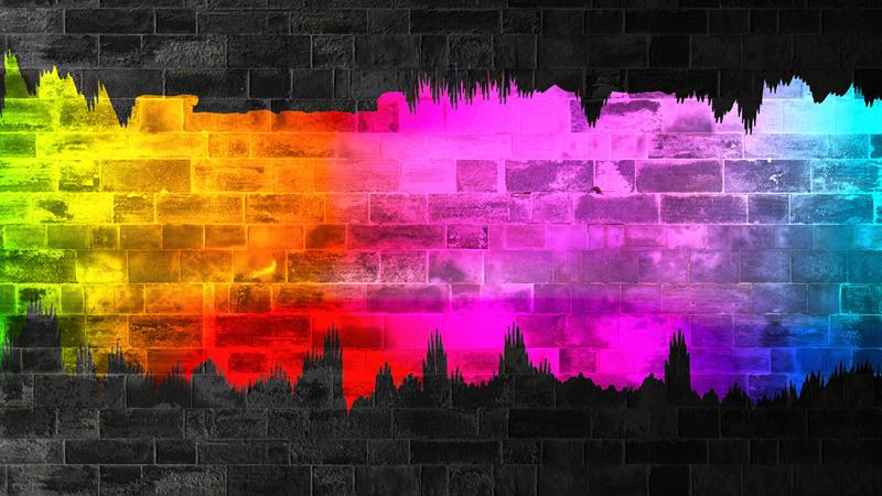 Graphic showing a rainbow stripe across a brick wall