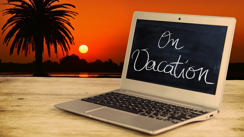 Image of a laptop displaying 'On vacation' message