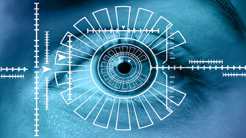 Close up image of a human eye overlaid with biometric-scanning information