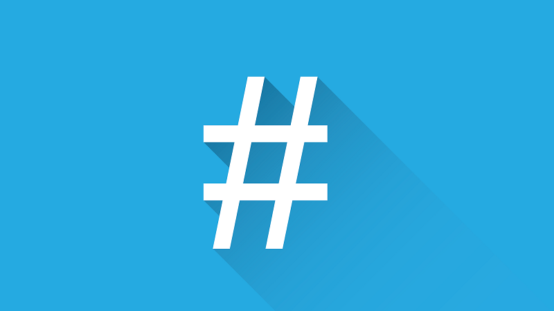 An image of a white hashtag logo on a light blue background