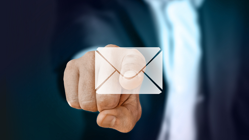 Image of a man's finger touching an email symbol