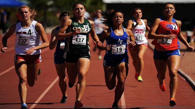 An image of women running a race on an athletics track