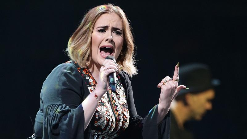 An image of singer Adele performing on stage