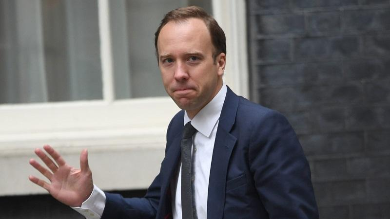 An image of culture secretary Matt Hancock arriving for a cabinet meeting at Downing Street and waving at the camera