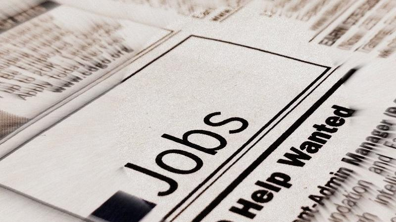 A close-up image of the 'Jobs' section of a newspaper