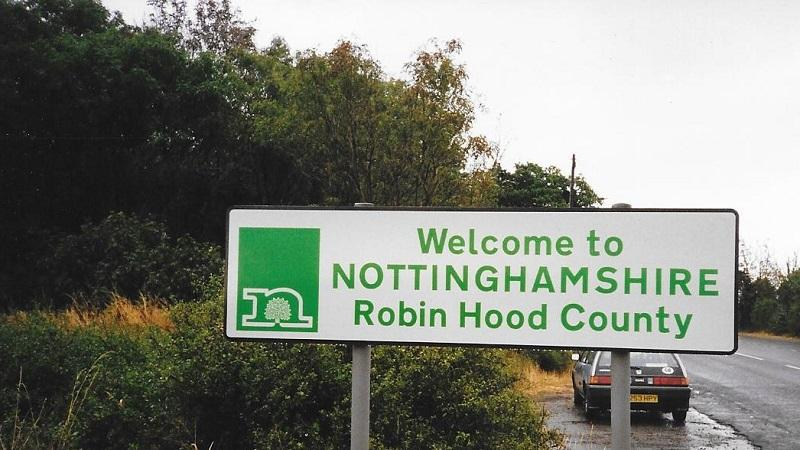 An image of a sign welcoming people to Nottinghamshire - 'Robin Hood County'