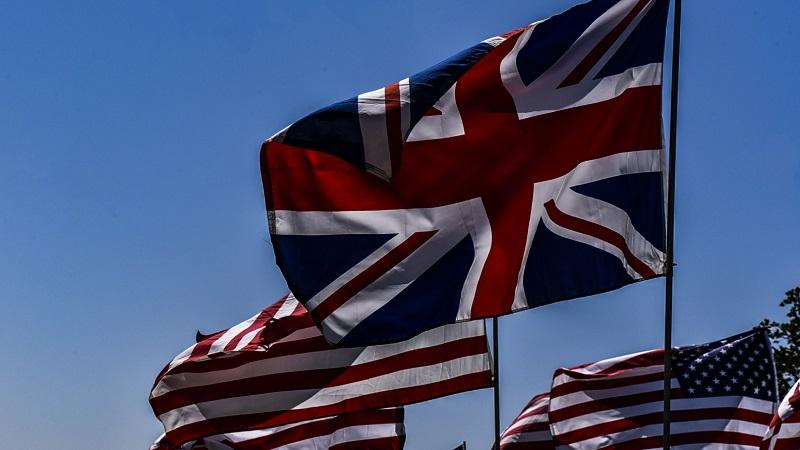 An image of the UK union flag and the US stars and stripes flying next to one another