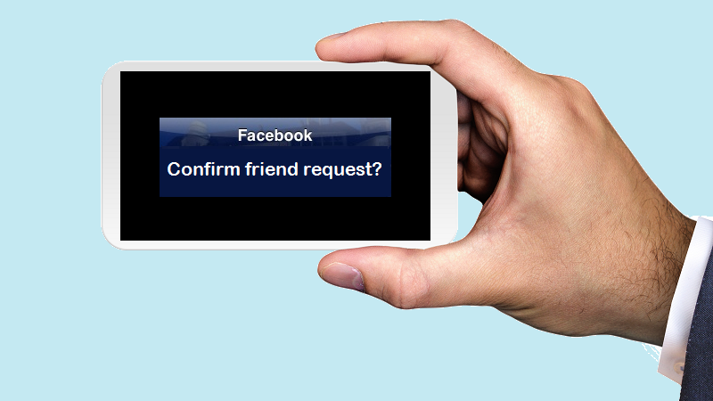 An image of a man's hand holding a phone landscape style with the screen displaying a message asking for confirmation of a Facebook friend request