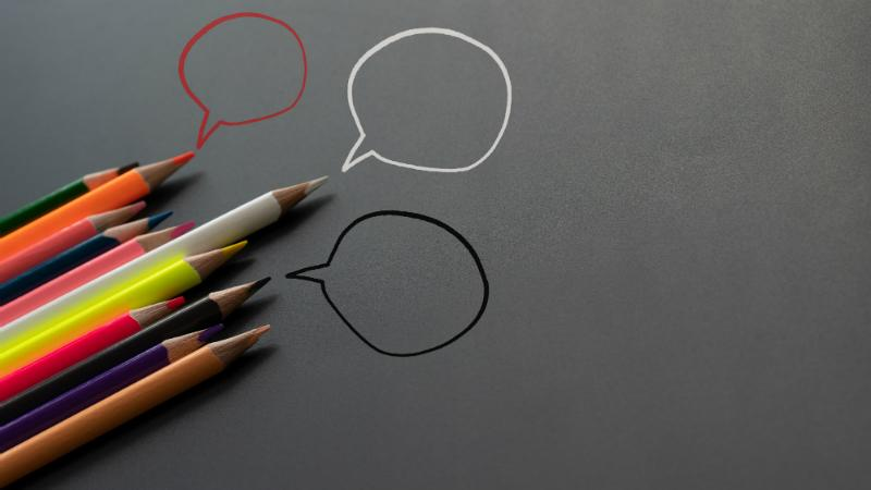 group of pencils sharing idea on the black background