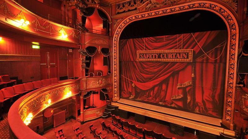An image of the stage and empty auditorium at the Theatre Royal in Stratford in east London