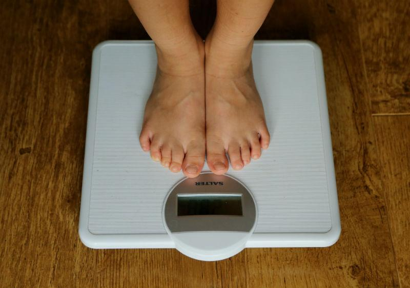 image of a pair of feet on a pair of scales
